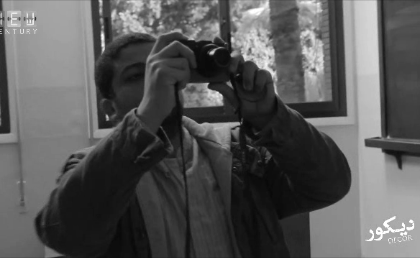 Director Ahmad Abdalla shooting a test shot on his personal camera on the set of Décor (2014). Courtesy of: New Century Film Production